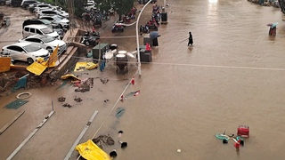 Flood covers subway, trains on roof in water to Henan province, Zhengzhou city, China