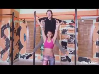 Hot Athletic girl lifts two girls and overheads