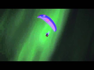 Paragliding with the Northern Lights, (Aurora Borealis), at Tromsø in Norway.