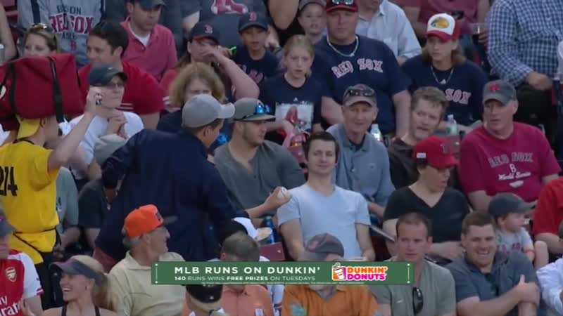 Teenage fan gives foul ball to young child