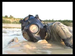 Latex catsuit in girl gasmask