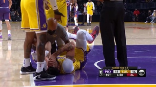 Anthony Davis is down in serious pain after taking an elbow to the face from Ayton